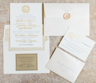 white-and-gold-wedding-invitation-suite-with-gold-wax-seal-and-gold-calligraphy