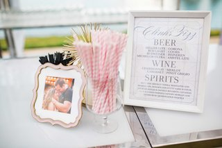 framed-bar-menu-with-pink-and-white-striped-straws-framed-photo-of-bride-and-groom