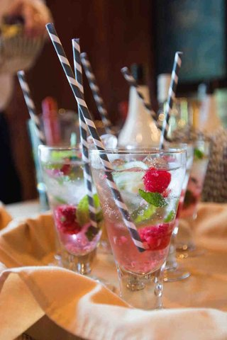 black-and-white-straw-with-raspberries-and-water