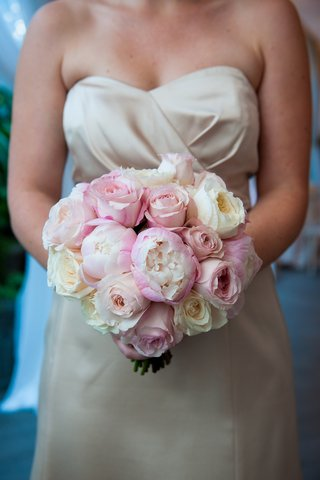 bridesmaid-in-ivory-dress-holding-pink-and-white-bouquet