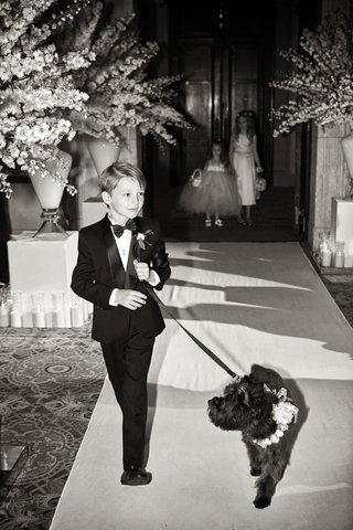 black-and-white-photo-of-grooms-son-ring-bearer-and-dog-with-flower-collar-ceremony