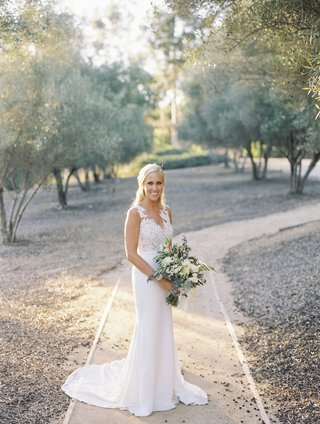 blonde-bride-in-pronovias-gown-with-crepe-skirt-and-lace-bodice