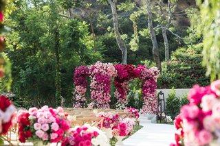 wedding-ceremony-pink-flower-chuppah-and-white-aisle-runner-backyard-wedding-ceremony