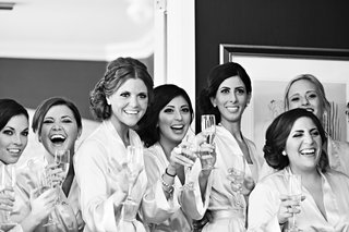 black-and-white-photo-of-bridesmaids-in-suite