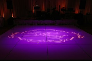 purple-lighting-monogram-on-dance-floor