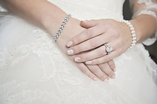 bridal-manicure-with-lace-accent-and-jeweled-accent-nude-blush-polish