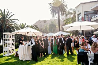 sunny-cocktail-hour-outdoor-at-bel-air-bay-club-southern-california-wedding-ideas-umbrellas