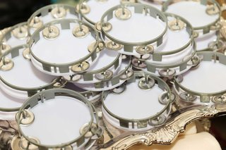 white-tambourines-with-grey-silver-details-for-wedding-reception-entertainment