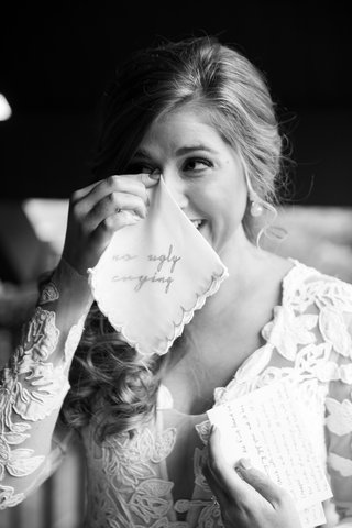 black-and-white-photo-of-bride-dabbing-eyes-with-handkerchief-with-no-ugly-crying-embroidery