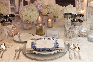 wedding-reception-table-silver-charger-plate-and-menu-card-rimmed-glassware-white-hydrangea-candles