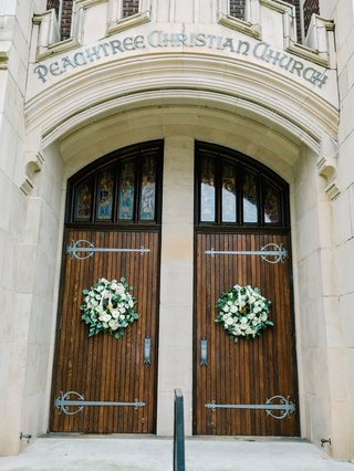 wedding-ceremony-peachtree-christian-church-atlanta-wood-doors-green-white-wreaths-decor-winter
