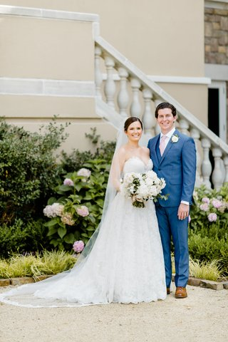bride-in-strapless-romona-keveza-wedding-dress-updo-veil-groom-in-blue-suit-vest-pink-tie-brown-shoe