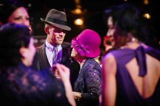 scott-blokker-in-fedora-with-older-guest-in-pink-hat