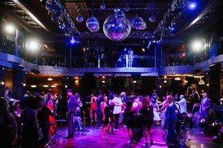 wedding-guests-dancing-in-club-like-reception-atmosphere