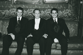 black-and-white-photo-of-formal-groom-and-two-sons