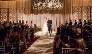 wedding-guests-at-ceremony-jewish-wedding-hanging-chuppah-flowers-orchid-lily-rose-hydrangea-stock