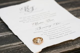 wedding-rings-on-wedding-invitation-yellow-gold-oval-diamond-solitaire-with-pave-diamond-band