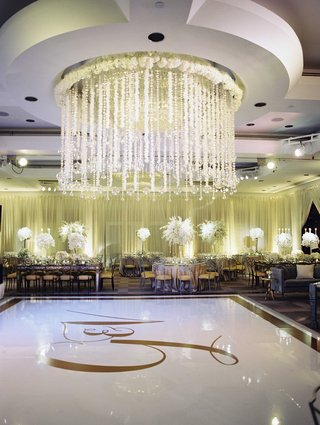 white-dance-floor-with-gold-monogram-and-border-crystal-orb-flower-garland-ceiling-treatment-design