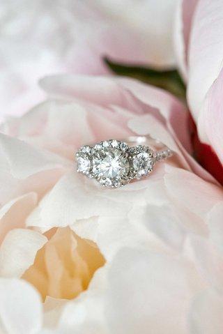 three-stone-diamond-engagement-ring-with-three-halo-settings-and-diamond-band