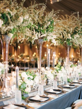 tall-centerpiece-flowers-with-small-short-flowers-in-between-on-mirror-runner-candles-dark-details