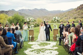 wedding-ceremony-on-grass-golf-course-lawn-silverleaf-club-in-scottsdale-arizona-flower-petal-aisle