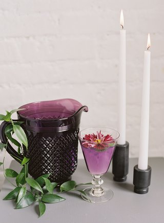 wedding-event-drink-ideas-purple-pitcher-with-purple-drink-cocktail-fresh-edible-flower-on-top