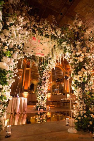 mirror-floor-with-flower-chuppah-with-mirror-floor-and-white-flowers-greenery-the-plaza-hotel