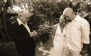 sepia-tone-image-of-outdoor-wedding-blessing-in-montecito