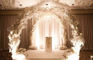 white-branch-and-flower-arch-for-indoor-wedding-ceremony