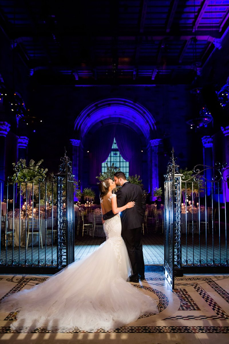 Couple Kisses at Reception Entrance