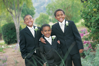 young-boys-in-formal-suits-and-floral-boutonnieres