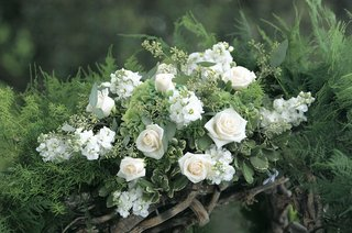 close-up-photo-of-white-flower-chuppah-decorations