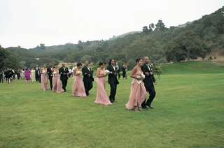 bridesmaids-and-groomsmen-cross-grass-lawn