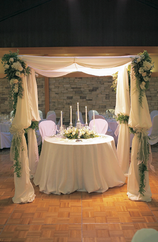 white-sweetheart-table-under-fabric-canopy