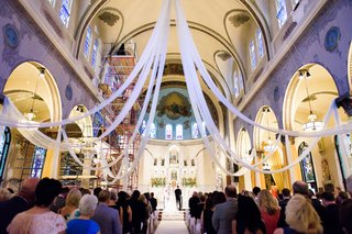 catholic-church-wedding-ceremony-with-white-drapery
