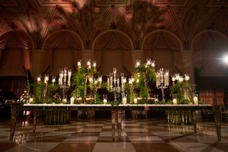 escort-card-table-with-lots-of-candelabra-and-lots-of-greenery