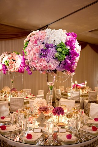 pink-purple-green-and-blue-flower-centerpiece-at-reception