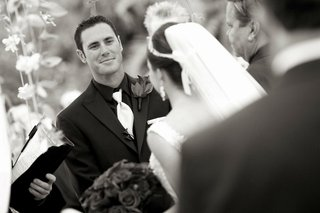black-and-white-photo-of-man-at-wedding