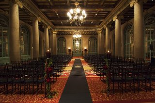 wedding-ceremony-with-black-chairs-and-aisle-runner-at-the-emerald-room-of-the-millennium-biltmore