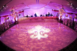 monogram-wedding-dance-floor-with-pink-lighting