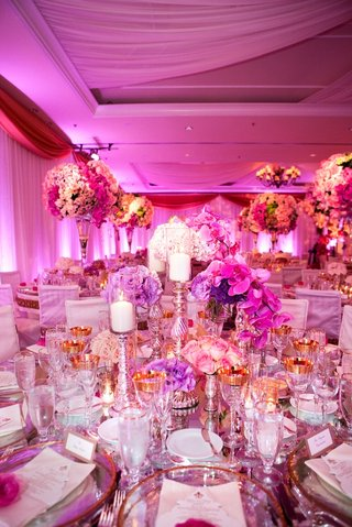 fuchsia-orchid-and-mercury-glass-candleholders-at-wedding
