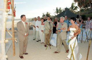 bride-approaches-groom-at-beach-ceremony