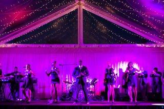 singers-on-stage-illuminated-by-purple-lighting