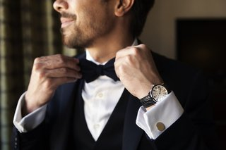man-wearing-tuxedo-and-bow-tie-with-cuff-links