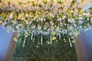 lush-white-roses-and-tulips-suspended-from-the-ceiling