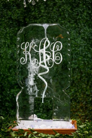 wedding reception cocktail hour hedge wall custom ice sculpture with monogram ice luge