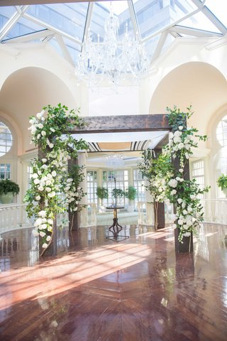 couples-wooden-tallit-chuppah-bedecked-white-flowers-green-foliage-for-traditional-jewish-ceremony