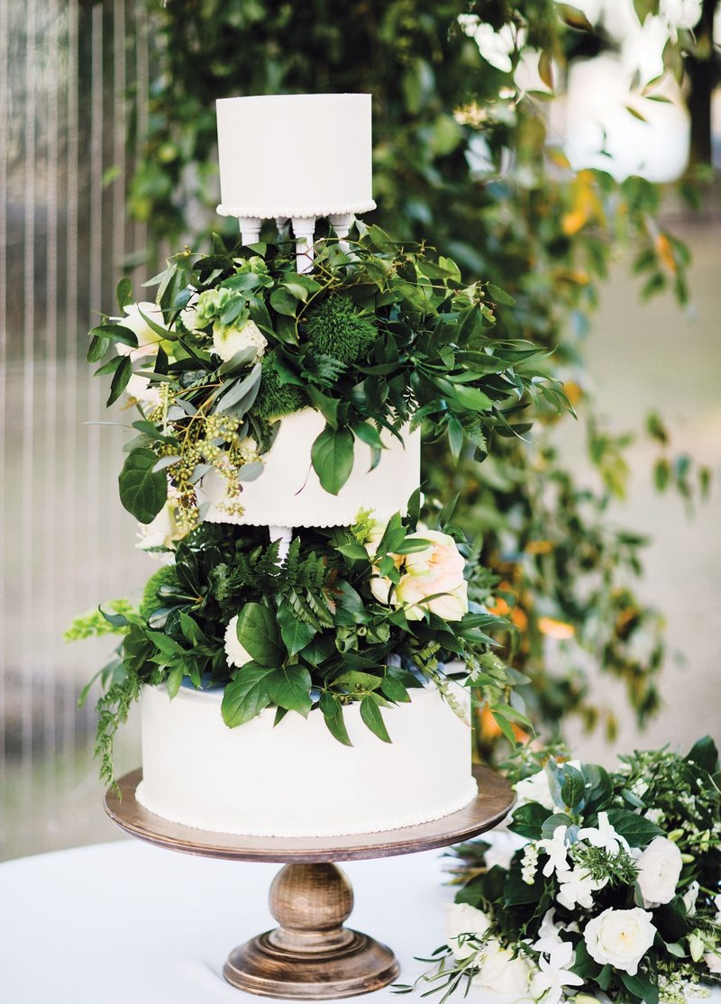 Unique White Cake with Greenery Tiers