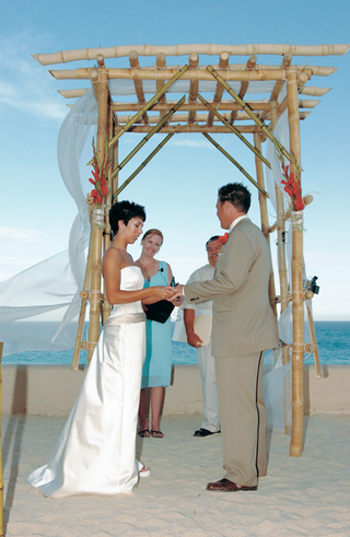 bamboo-beach-wedding-altar-with-red-flowers