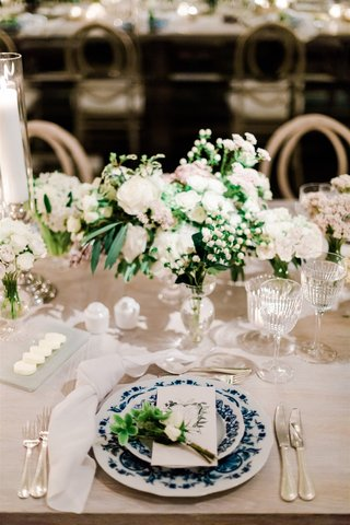 wedding reception rustic white wood table no linens with blue and white chinoiserie plate sprig